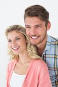 Attractive young couple looking away — Stockfoto