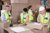 Warehouse workers preparing shipment in — Stock Photo