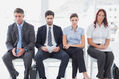 Business people sitting in a row — Stock Photo