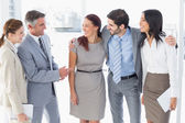 Business team chatting and smiling — Stock Photo