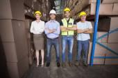 Warehouse team smiling at camera — Stock Photo