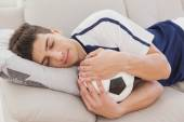 Football fan sleeping with ball — Stock Photo