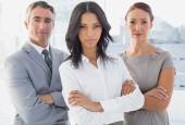 Serious businesswoman with folded arms — Stock Photo