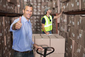 Warehouse manager with trolley — Stock Photo
