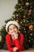 Festive little girl smiling at camera — Foto de Stock