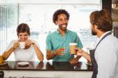 Barista serving two happy customers — Stock Photo