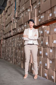 Pretty warehouse manager smiling at camera — Stok fotoğraf