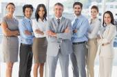 Happy workers standing all together — Stock Photo