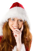 Festive redhead with hand on chin — Stock Photo
