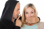 Close up of theft covering woman's mouth — Stock Photo