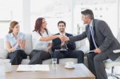 Businessman shaking an employee's hand — Stock Photo