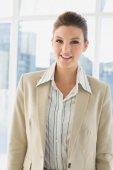 Pretty businesswoman smiling at camera — Stock Photo