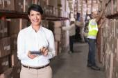Warehouse manager using calculator — Foto de Stock