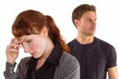 Worried woman with man behind — Stock Photo