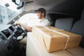 Delivery driver driving van — Stock Photo