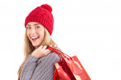 Festive blonde holding shopping bags — Stock Photo