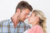 Romantic young couple about to kiss — Stockfoto