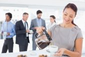 Businessman pouring himself some coffee — Stock Photo