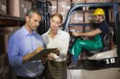 Warehouse team working together with clipboard — Stock Photo