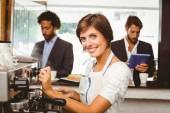 Pretty barista making cup of coffee — Photo