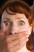 Terrified woman with covered mouth — Stock Photo