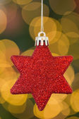 Red christmas star decoration hanging — Stockfoto
