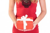 Classy woman holding a gift — Stock Photo