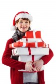 Smiling woman holding christmas presents — Stockfoto