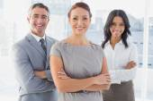 Businesswoman smiling with folded arms — Stock Photo