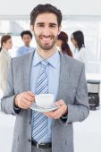Smiling businessman with a drink — Foto de Stock