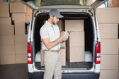 Delivery driver checking his list — Stockfoto