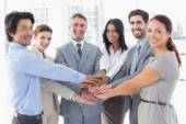 Business team stacking their hands — Stock Photo