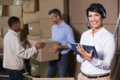 Warehouse manager using tablet — Stock Photo