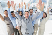 Cheering workers with raised arms — Stock Photo