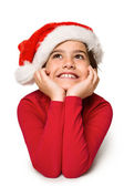 Festive little girl smiling and looking up — Stock Photo