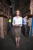 Warehouse manager smiling at camera — Stock Photo