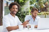 Two busy friends having coffee together — Stock Photo