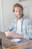 Casual man having a coffee — Stock Photo