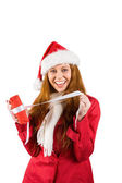 Festive redhead opening a gift — Stock Photo