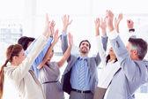 Business team raising their hands — Stock Photo