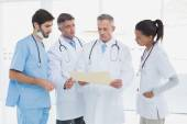 Medical team discussing some results — Stockfoto