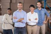 Warehouse workers smiling at camera — Stock Photo