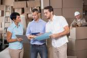 Warehouse workers talking together at work — Stock Photo