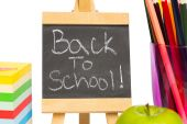 Back to school written on chalkboard — Stockfoto