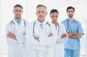 Medical team looking at camera — Стоковое фото