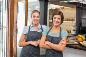 Pretty waitresses smiling at camera — Stock Photo