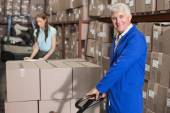 Warehouse foreman with trolley — Stock Photo