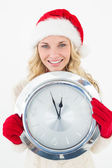 Portrait of attractive santa woman holding clock — Stockfoto