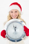 Portrait of attractive santa woman holding clock — Foto Stock