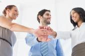 Business people with stacked hands — Stock Photo